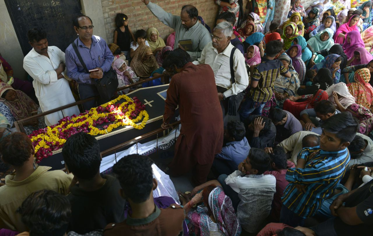 Pakistani Christians mourners attend a funeral ceremony of a blast victim of the March 27 suicide bombing, in Lahore on March 28, 2016. Pakistan's army launched raids and arrested suspects after a Taliban suicide bomber targeting Christians over Easter killed 72 people including many children in a park crowded with families. / AFP / ARIF ALI        (Photo credit should read ARIF ALI/AFP/Getty Images)